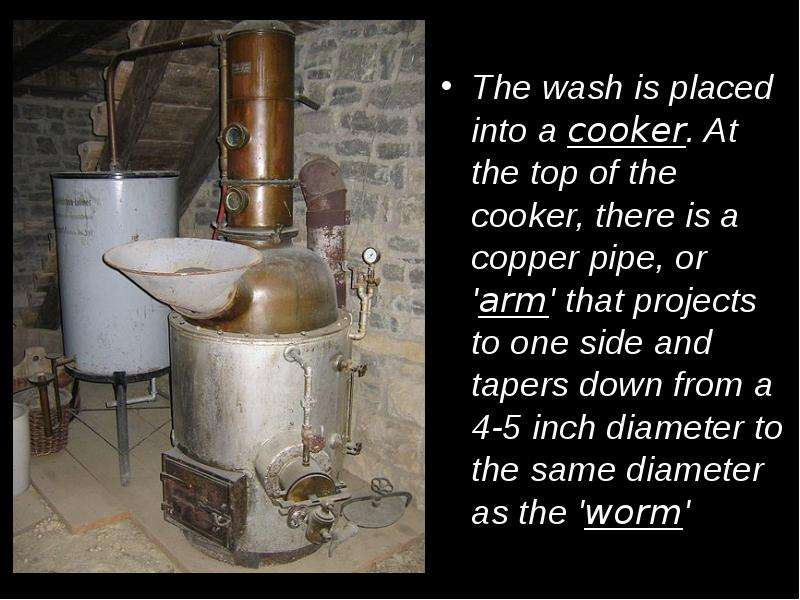 The wash is placed into a cooker. At the top of the cooker, there is a copper pipe, or arm that proj
